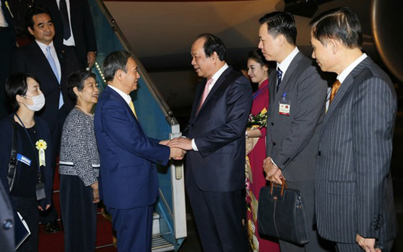 Suga arrives in Hanoi in first overseas trip as Japan PM