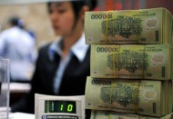 Vietnam c.bank cuts rate on banks' reserve requirements first time since 2005