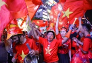 Vietnamese flood streets to celebrate historic football victory