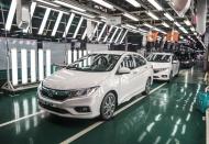 Cars imports, crude oil help Vietnam customs beat 2019 revenue target