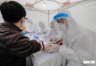 How quick coronavirus testing stations in Hanoi work?