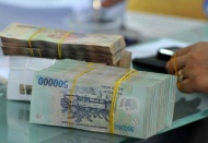 Vietnamese currency predicted to continue weakening: Fitch