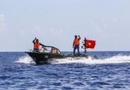 Vietnam asks China to resolve maritime disputes